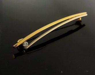 Gouden broche bicolor met diamant. Tweedehands