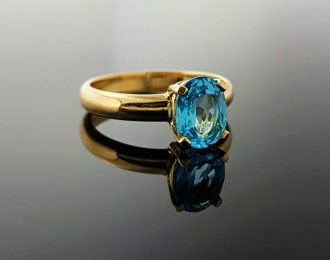 Gouden ring met Suisse Blue Topaas