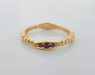 14 karaat rosé gouden ring met purple diamantjes